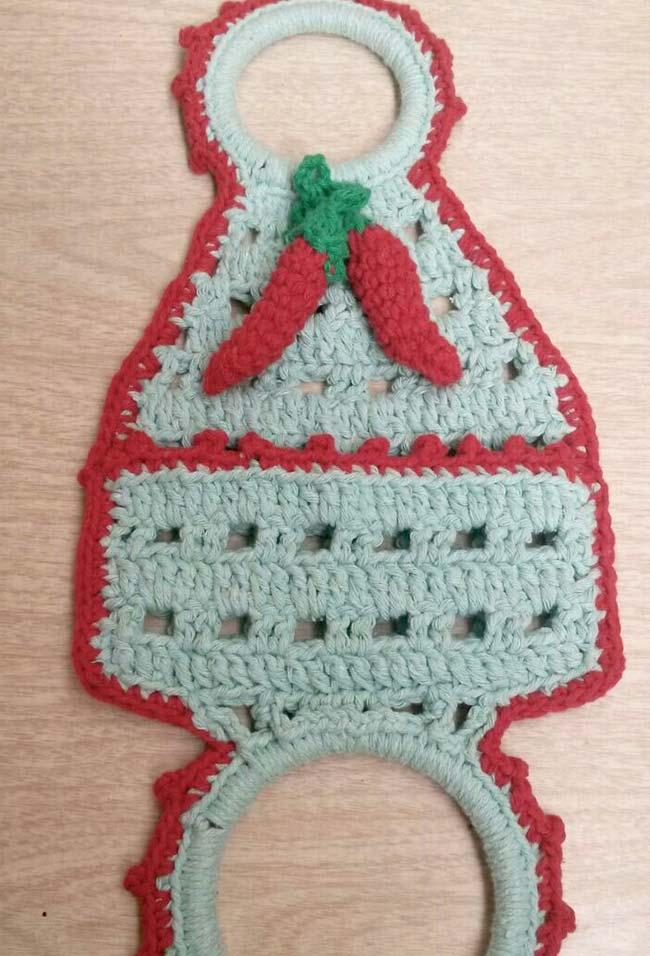 Crochet plate cloth holder with red peppers