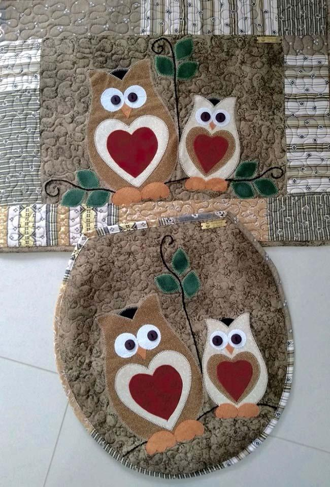 Patchwork of owls on brown background of bathroom set