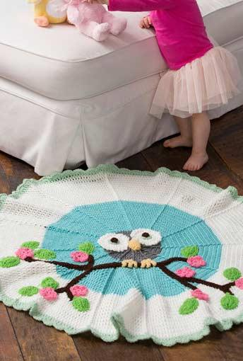 Owl in the center of this beautiful crochet tapestry