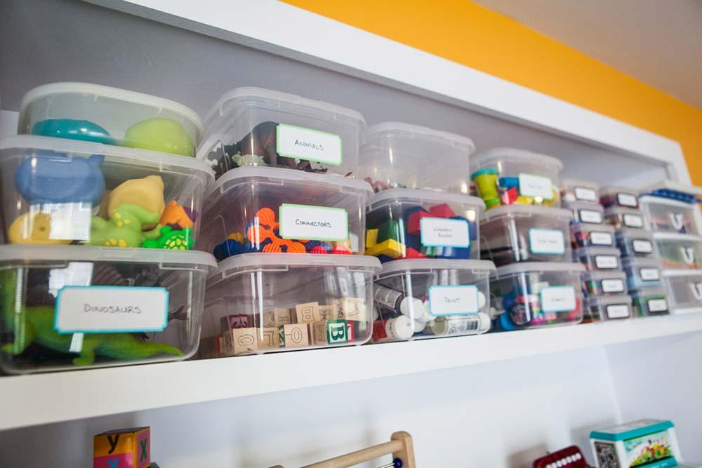 Use shelves and boxes to organize toys