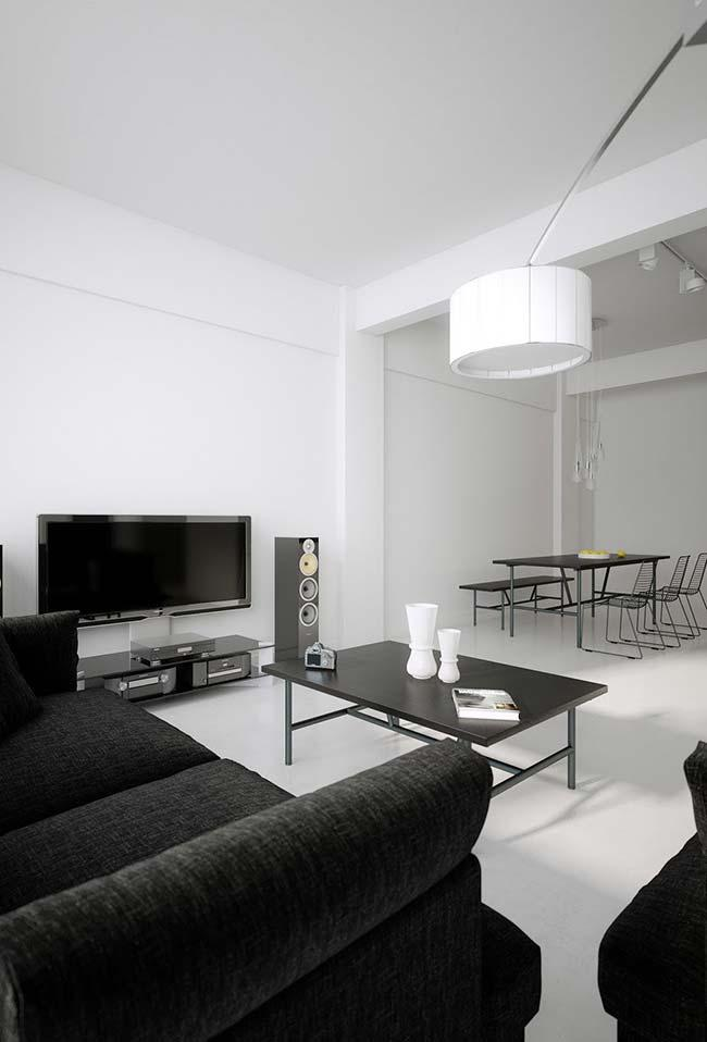 Black and white room reinforced in the decor with the use of white burnt cement