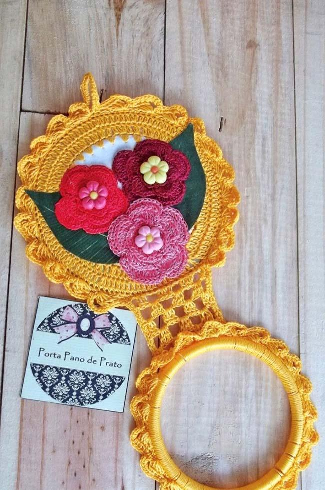 Crochet cloth holder made with CD and colorful flowers