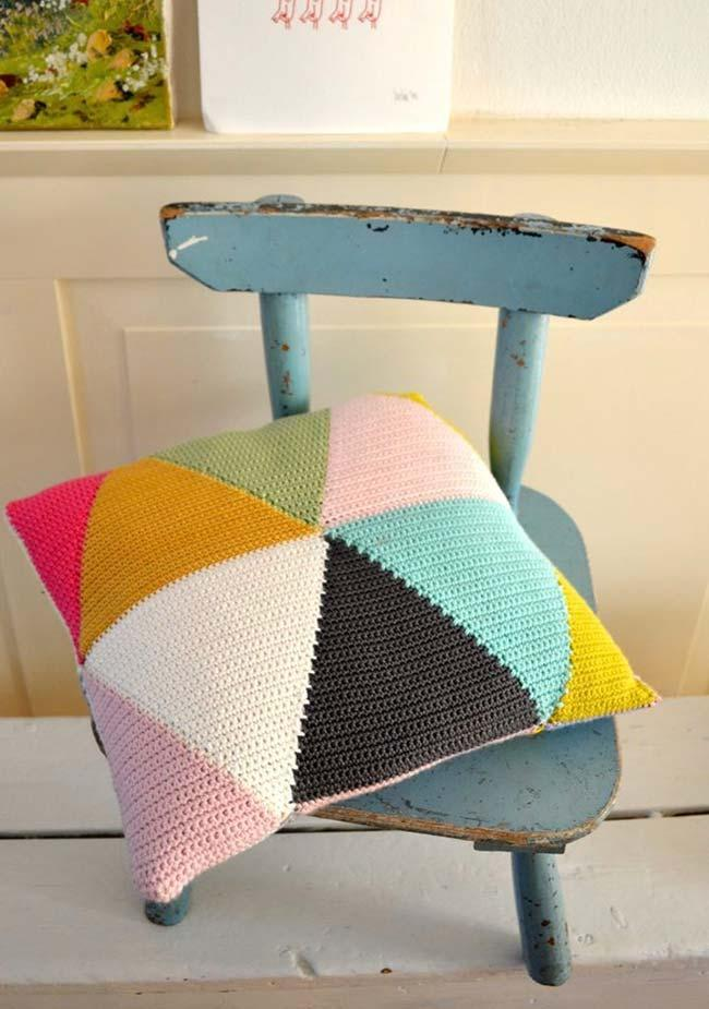 Crochet cushion cover made with colored triangles