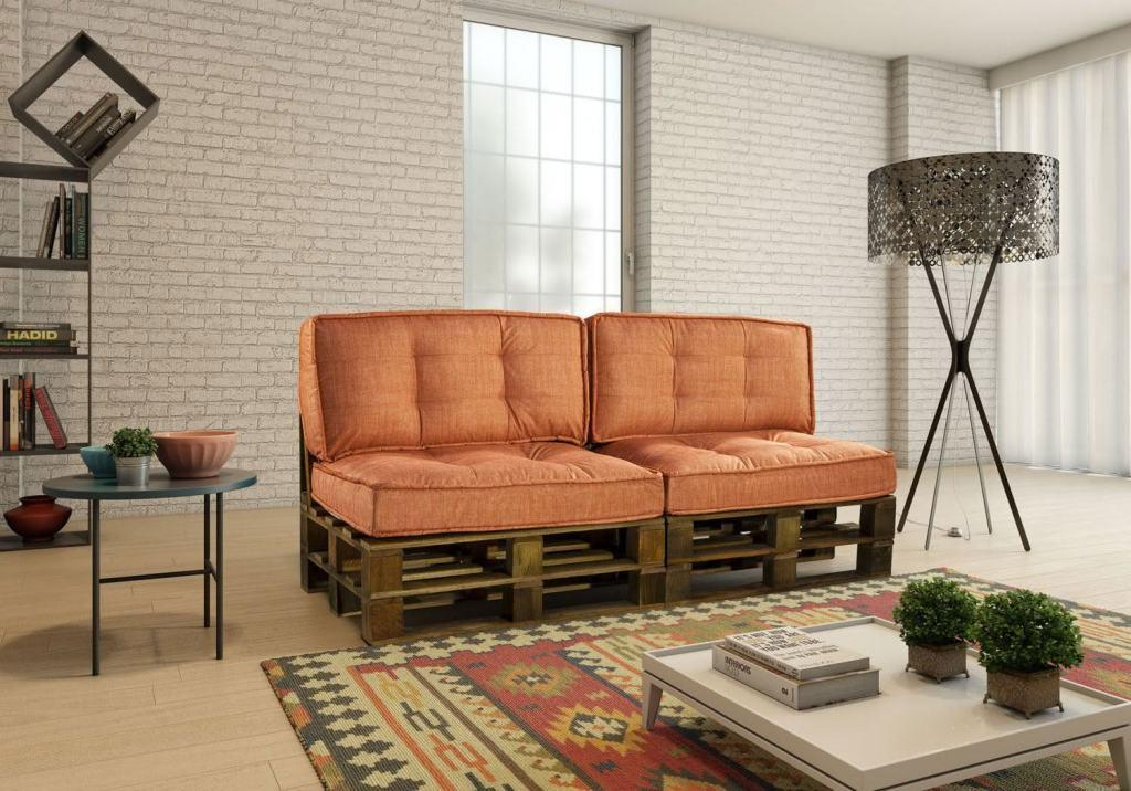 Sofa with pallet with orange cushions