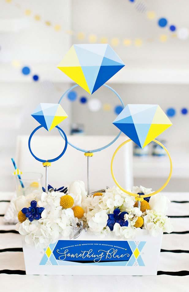 Somewhat unusual, the colors yellow, blue and white form the decoration of this simple engagement party