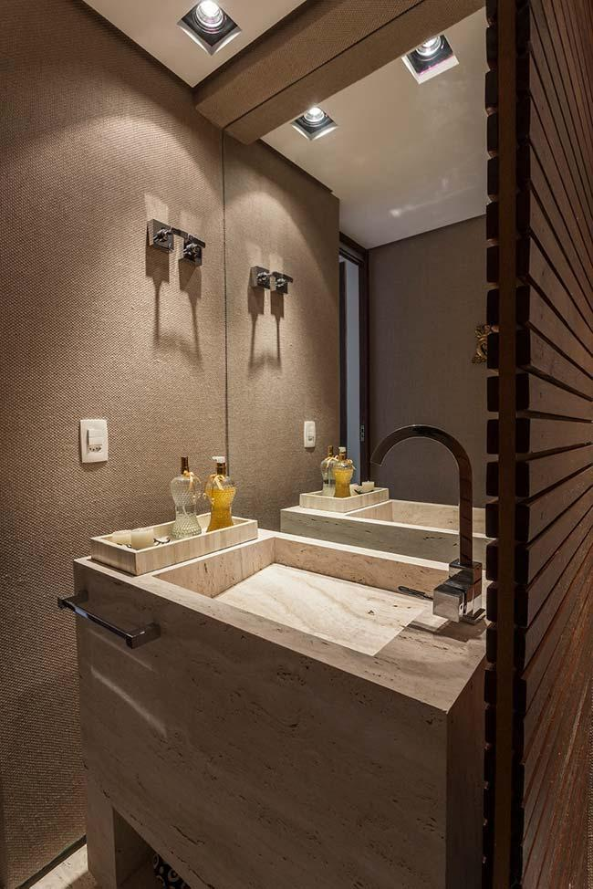 Directed lighting on the marble countertop makes the bathroom even more beautiful