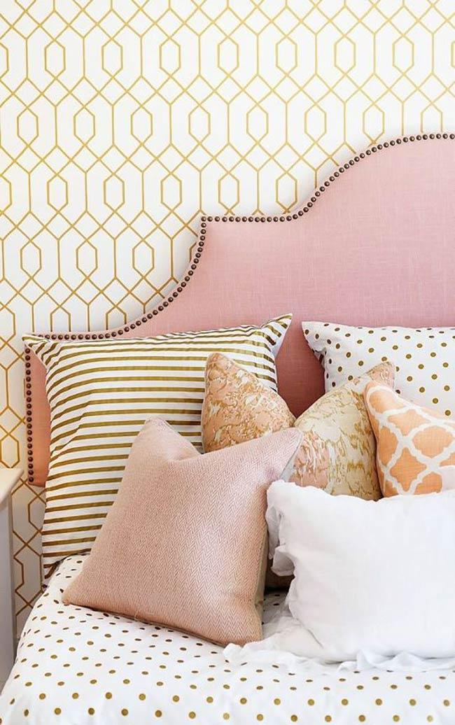 A female headboard with studs and the pink color