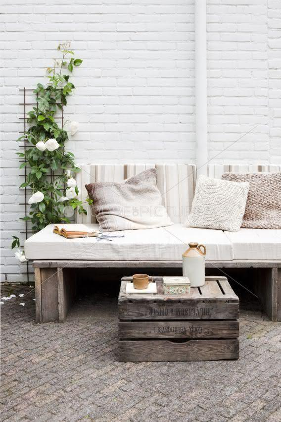 Rustic pallet on sofa