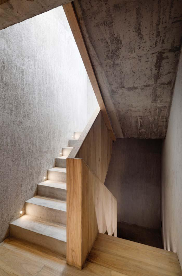 Concrete ladder with wooden guardrail