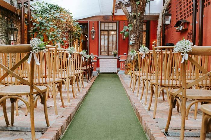 Small bouquets of white flowers decorate the chairs for the ceremony
