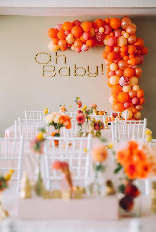Baby shower decoration with wall of colored bladders