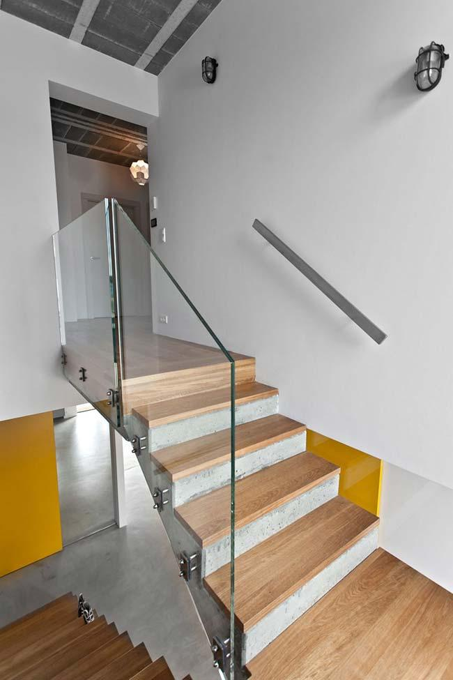 Wooden floor accompanies the staircase