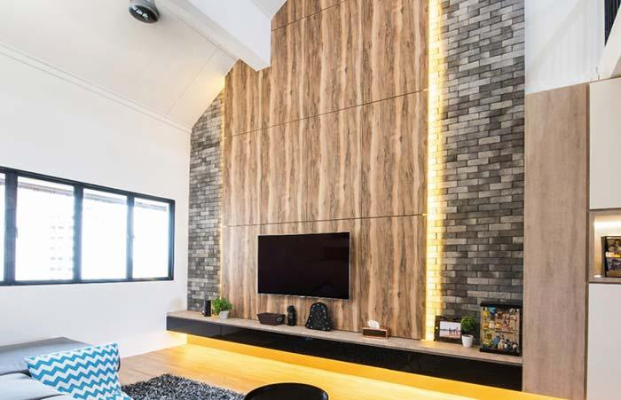Wooden panel over brick wall
