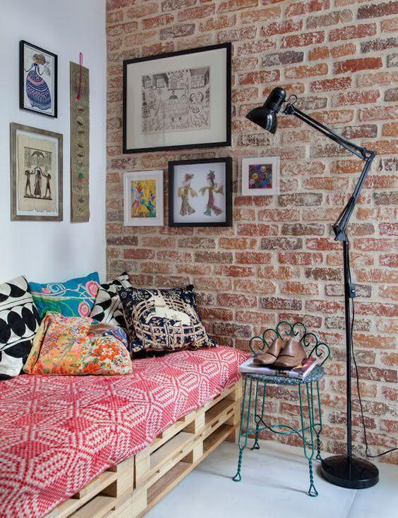 Room with brick wall and pallet sofa