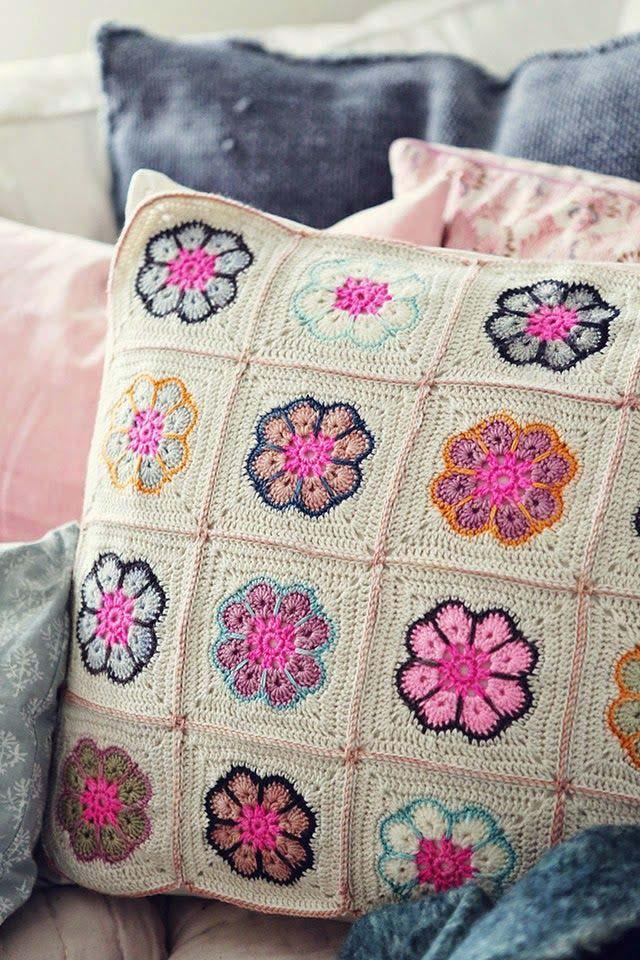 Crochet cushion cover made with squares of flowers
