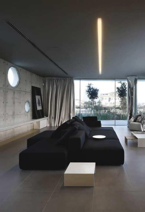 Two black mega sofas in the decoration