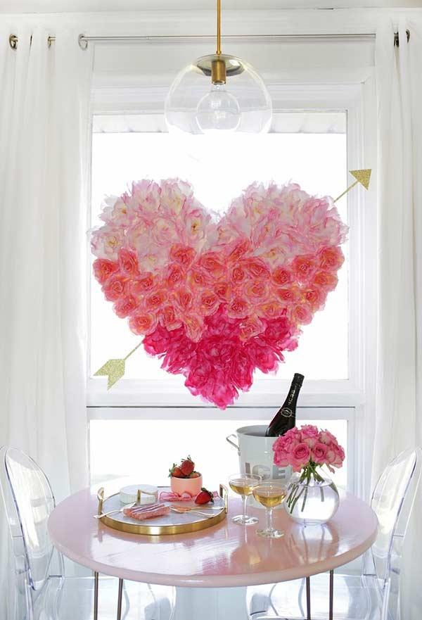 Arrangement with flowers hanging on a heart shaped plate