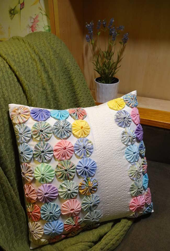 Colored pillow with various yo-yos