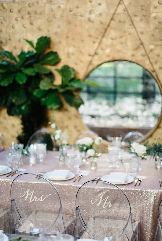 A detail in the bride and groom dining chair