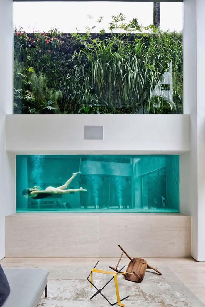 Glass wall dividing the pool from the living room