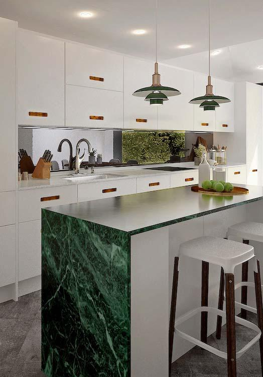 Green marble gives life to the white kitchen