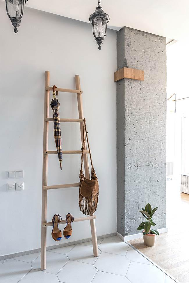 Ladder of objects as clothes rack