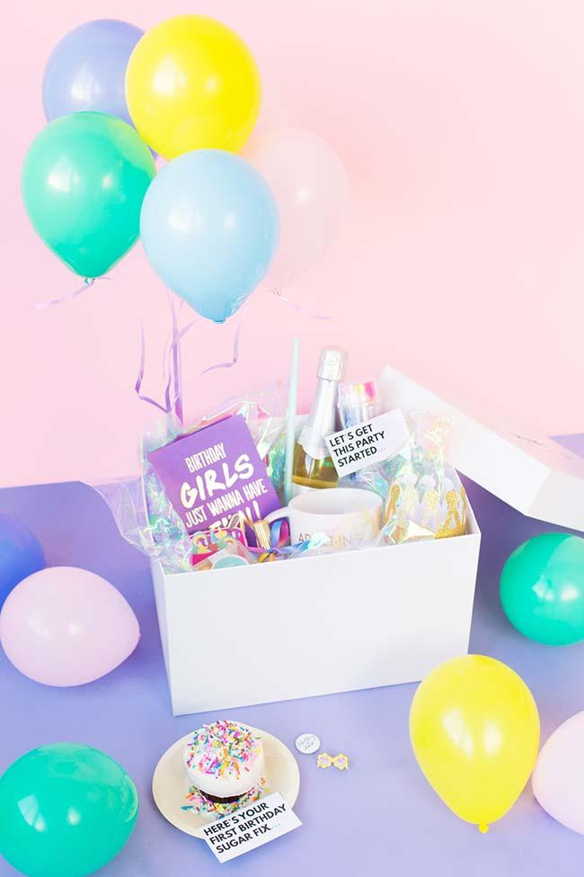 Balloons complement the party in the box