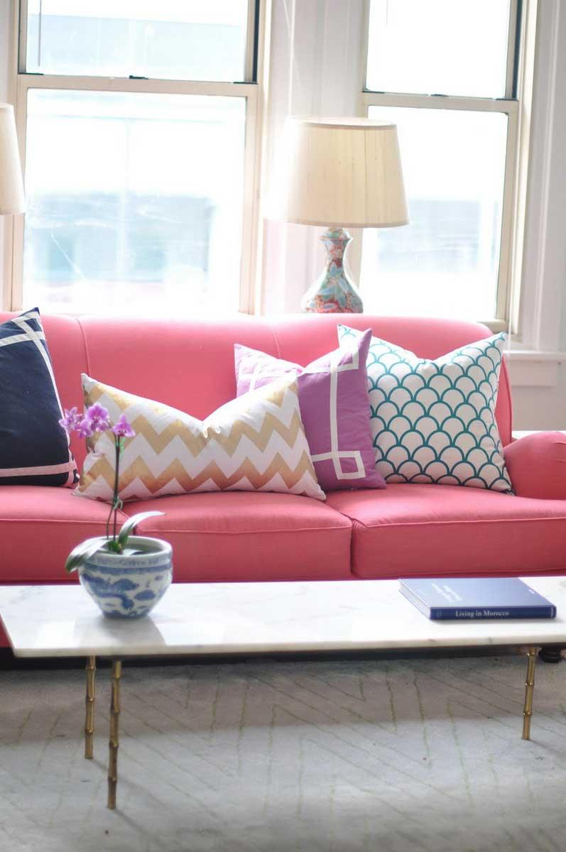 Colorful sofa with cushions with geometric designs