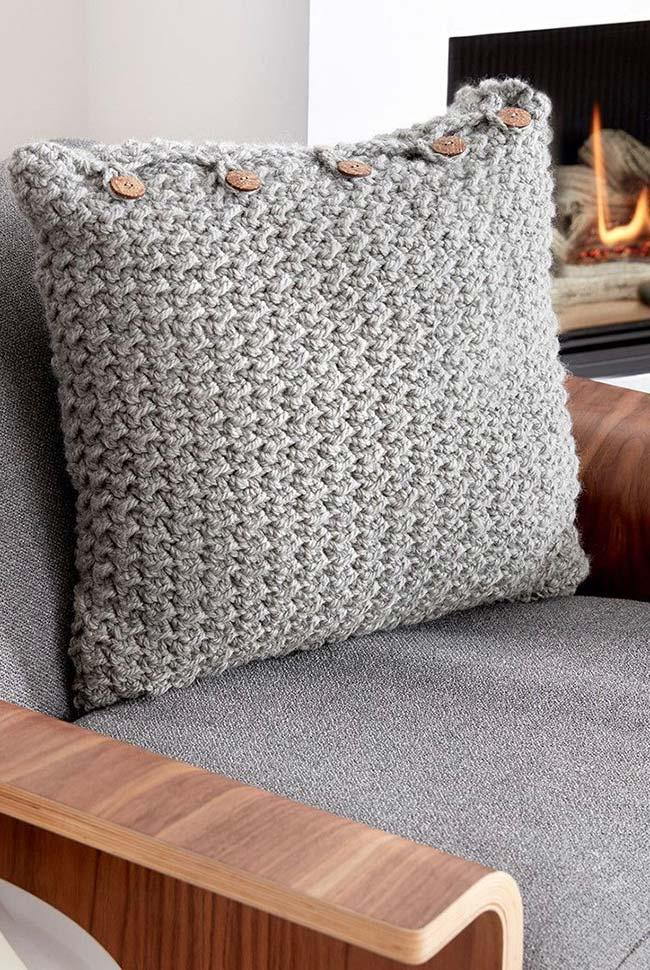 Wooden buttons on crochet cushion cover