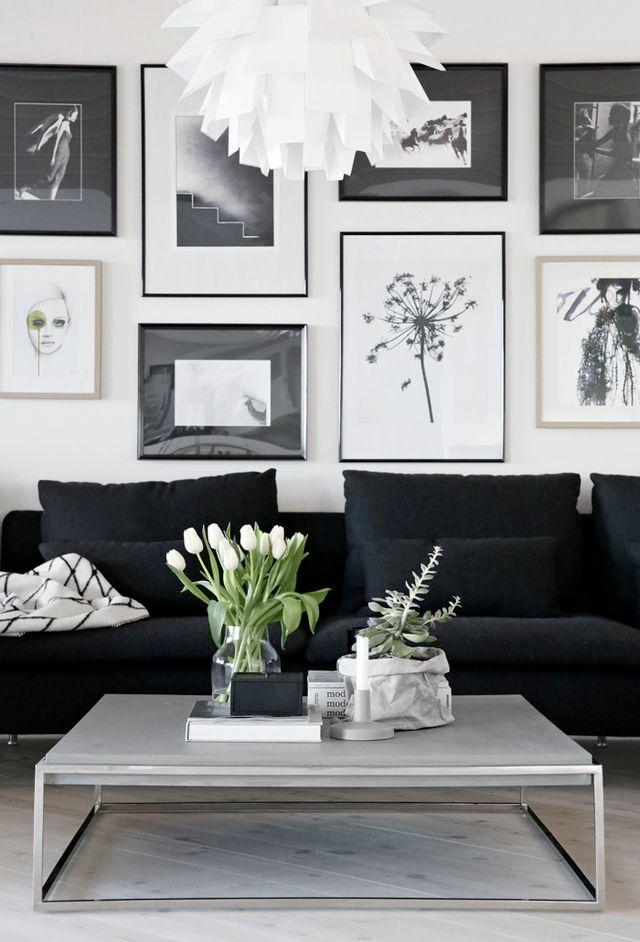 Modular black sofa in a fuller decor and a final touch of green