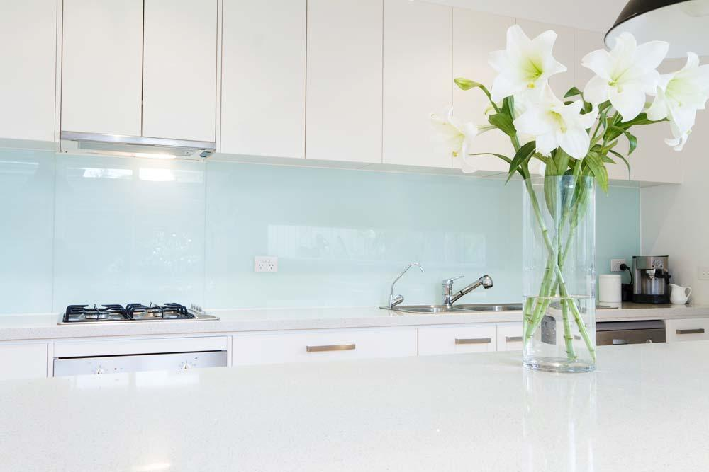 Lily flowers in vase in kitchen decoration