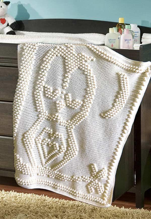 Embossed dots on blanket to form owl