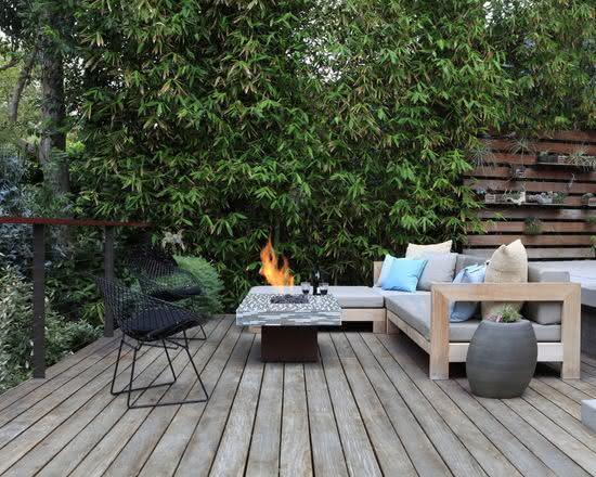 Pallet Sofa with Fireplace in Outdoor Area
