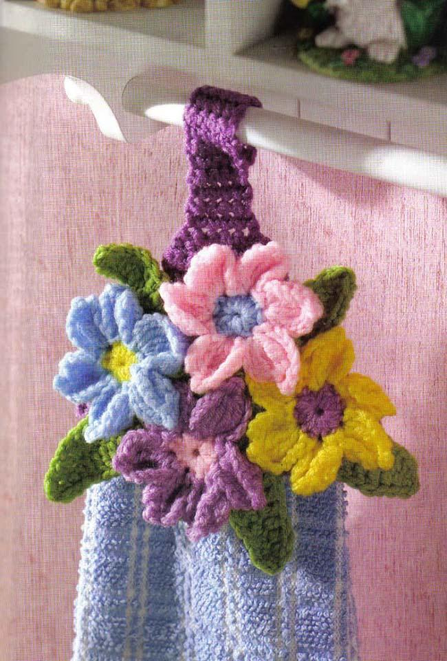 Colorful door flowers crochet dish cloth embellish the kitchen