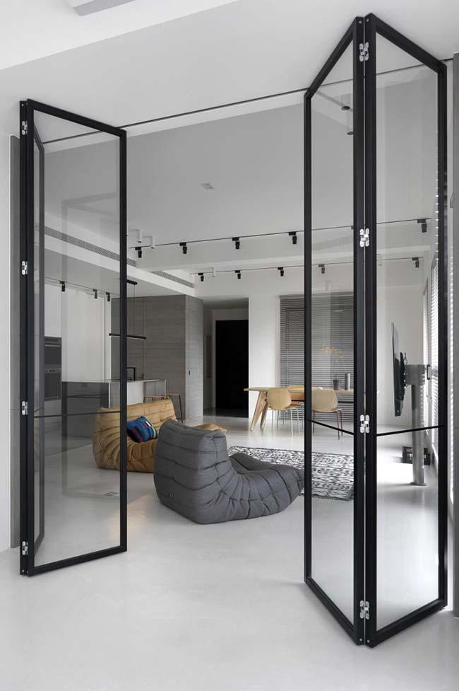 Glass hinged doors divide and isolate environments