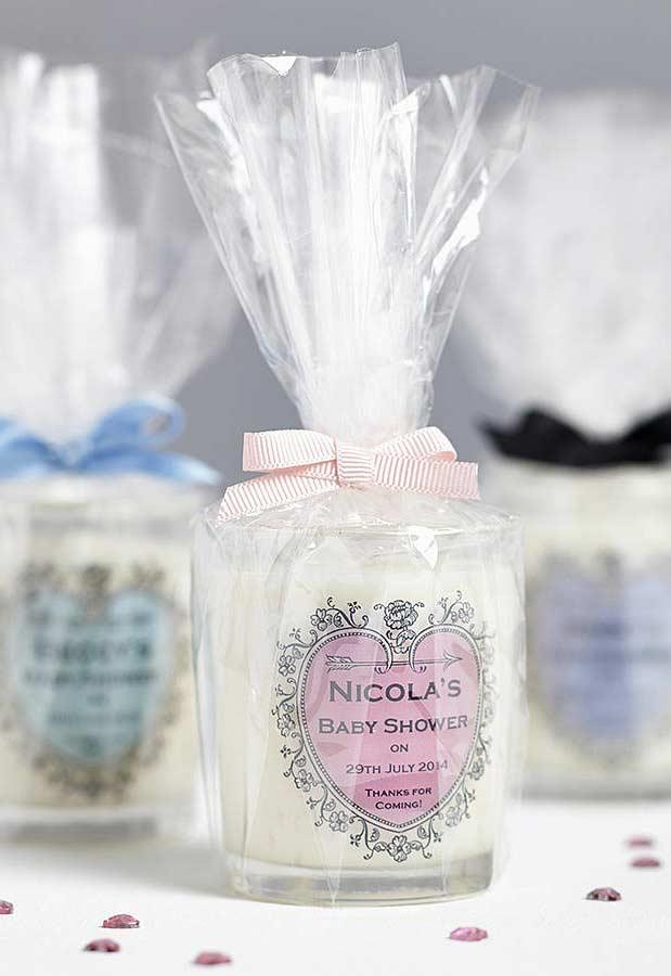 Scented candle in glass container as baby shower souvenir