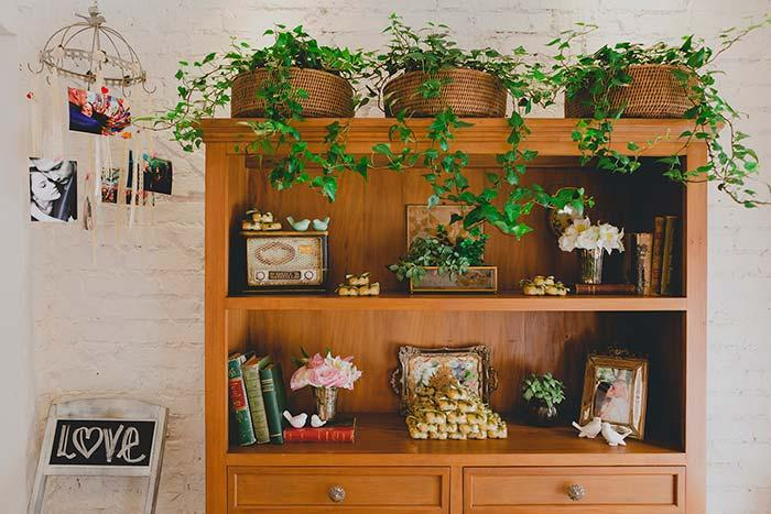 Integrate personal objects into party decor as books and picture frames