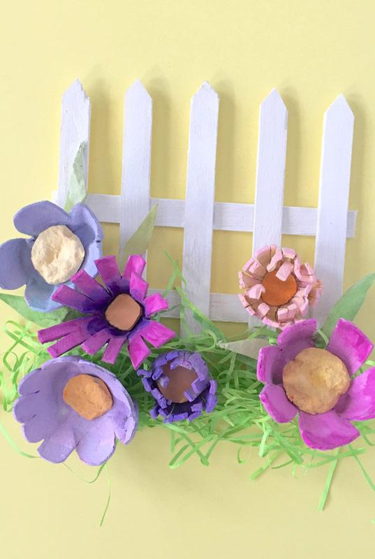 Flowery fence with egg cartons