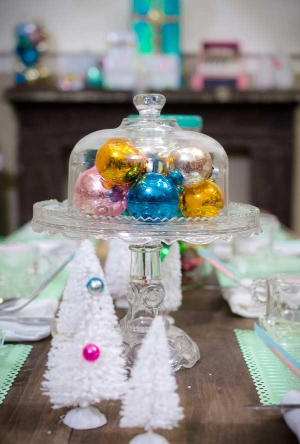 Colored Christmas balls on glass vase in centerpiece