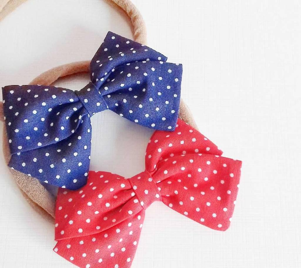 Blue and red ties with polka dot fabric