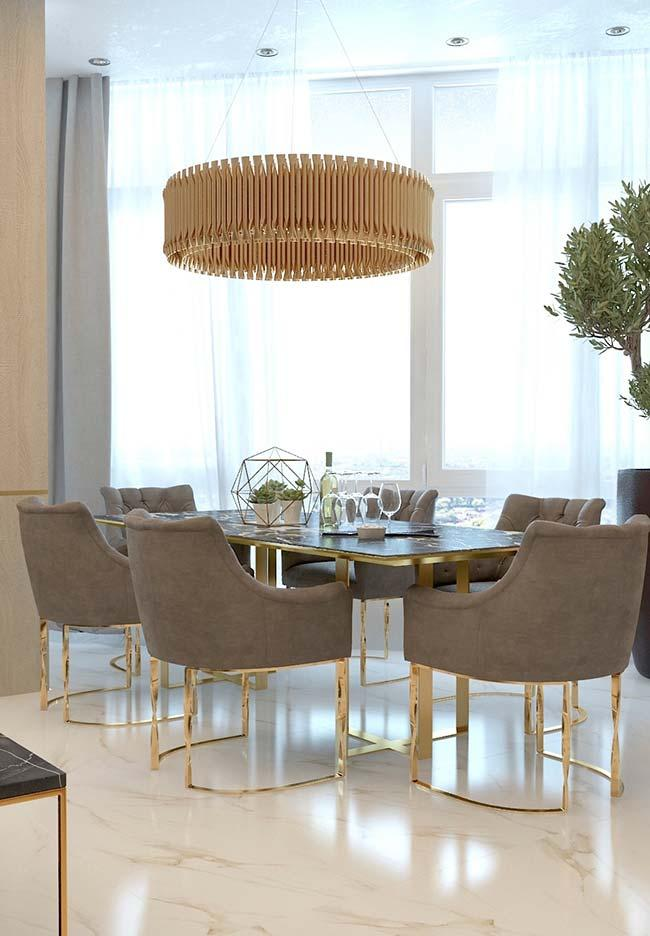 Calacatta marble gold on the floor and gold accents on furniture