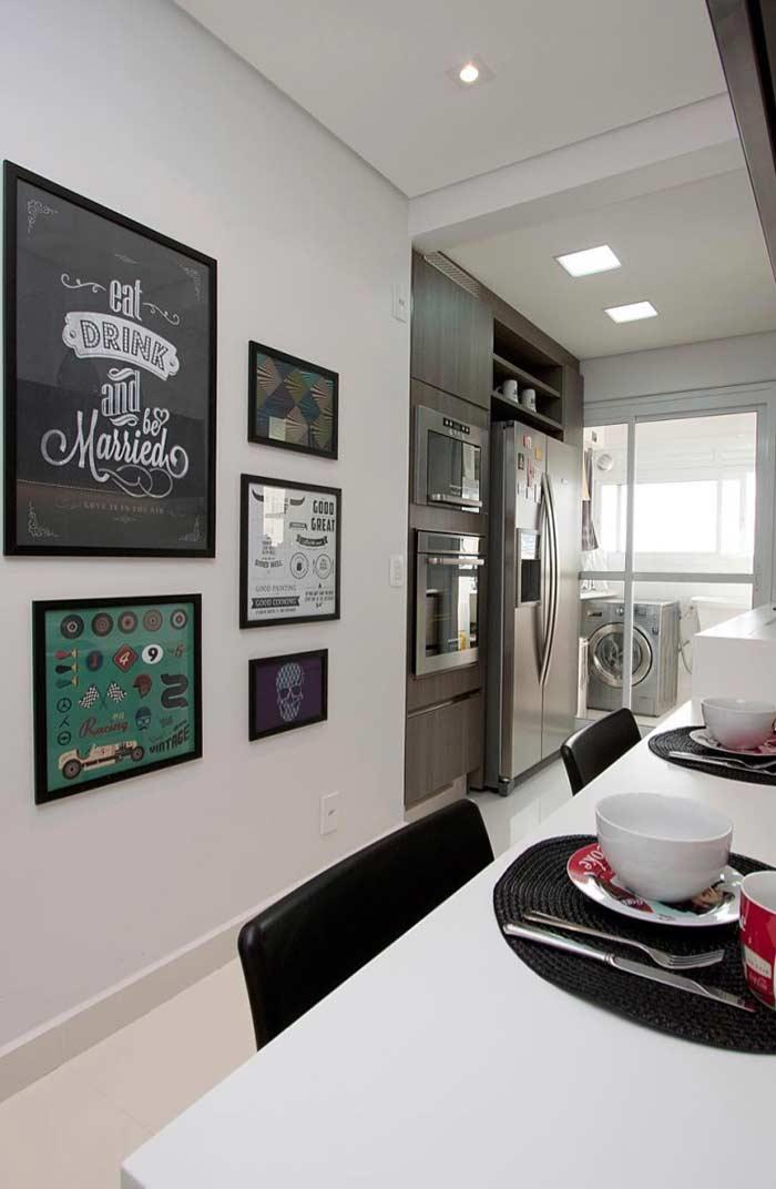 A beautiful and fun kitchen with decorative pictures