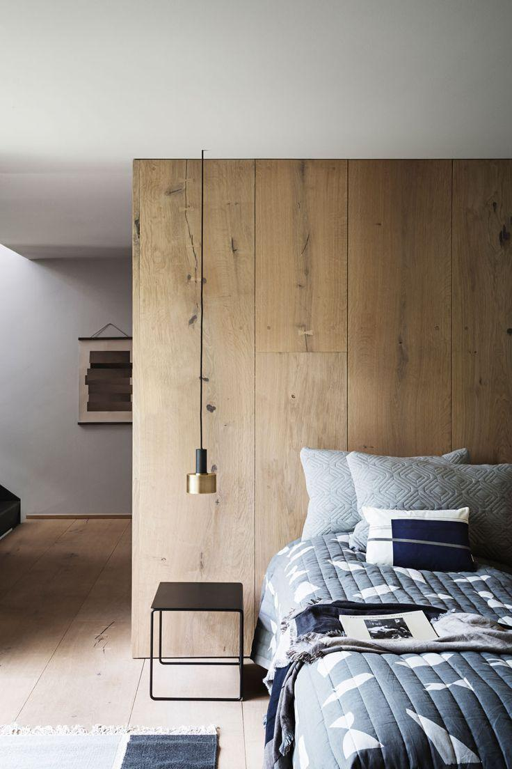Wooden headboard on the entire wall