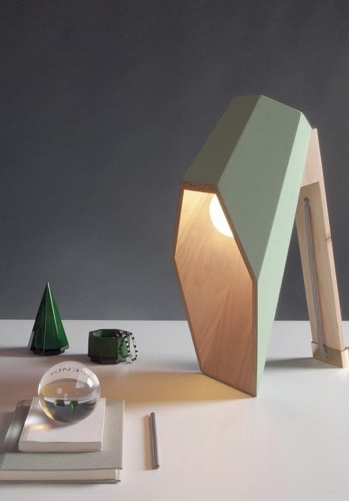 Wooden luminaire directs light to the table