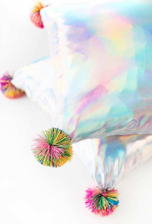 Holographic pillow with colorful pompom
