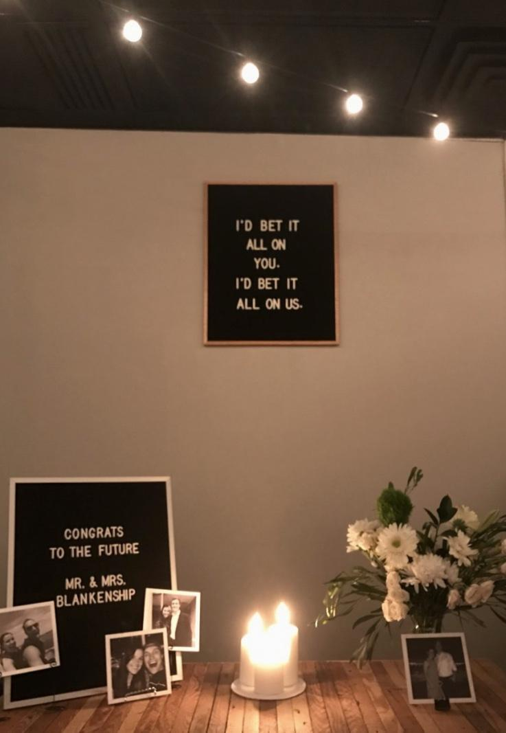 Simple engagement party decoration with pictures and candles