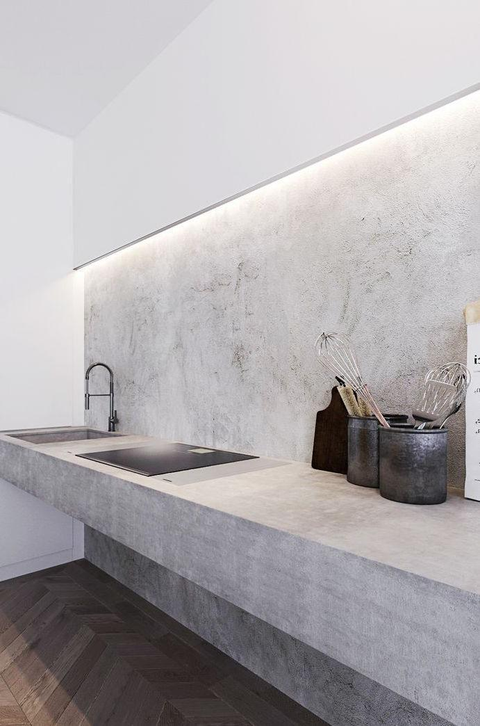 Minimalist kitchen gained prominence with white burnt cement wall