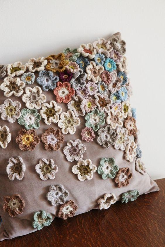 Cushion cover with applied crochet flowers