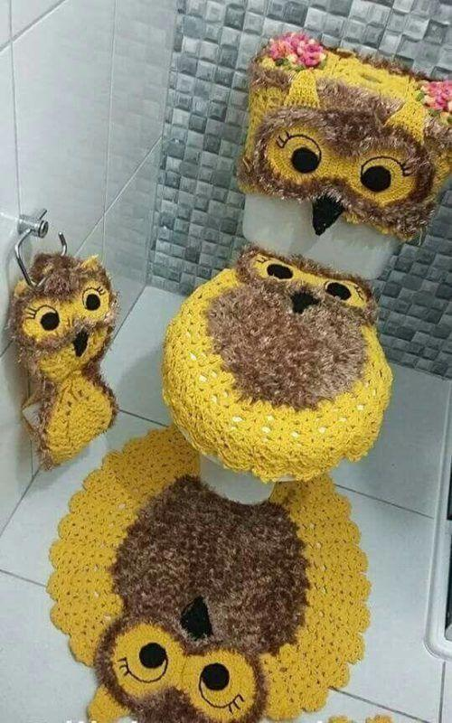 Gold yellow owl in bathroom