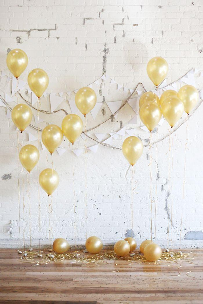 wedding decoration do it yourself: golden balloons filled with helium